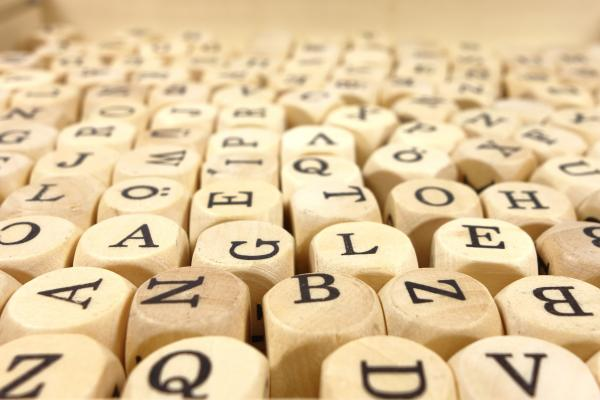 Wooden cubes with letters on